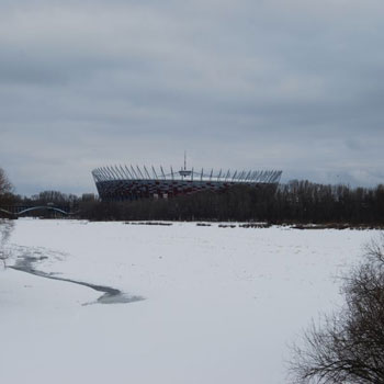 The Vistula river in winter against the National Stadium